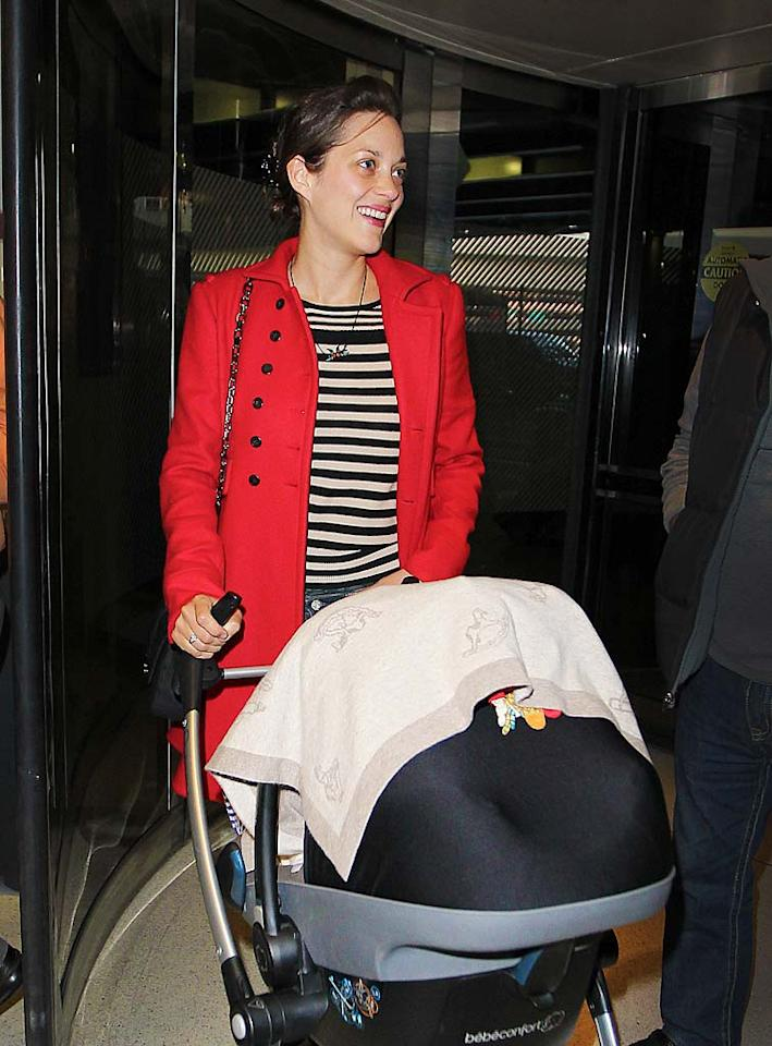 "Oscar-winning actress Marion Cotillard worked hard to keep her bundle of joy under wraps. But we do know this much: baby boy Marcel was born to Cotillard and her French boyfriend Guillaume Canet in May. Oh, and the ""Inception"" star is grinning every time we see mother and son together!"