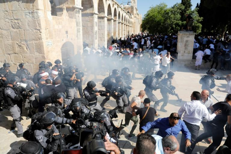 Israeli police fired sound grenades as Palestinian protests intensified at the flashpoint holy site in Jerusalem