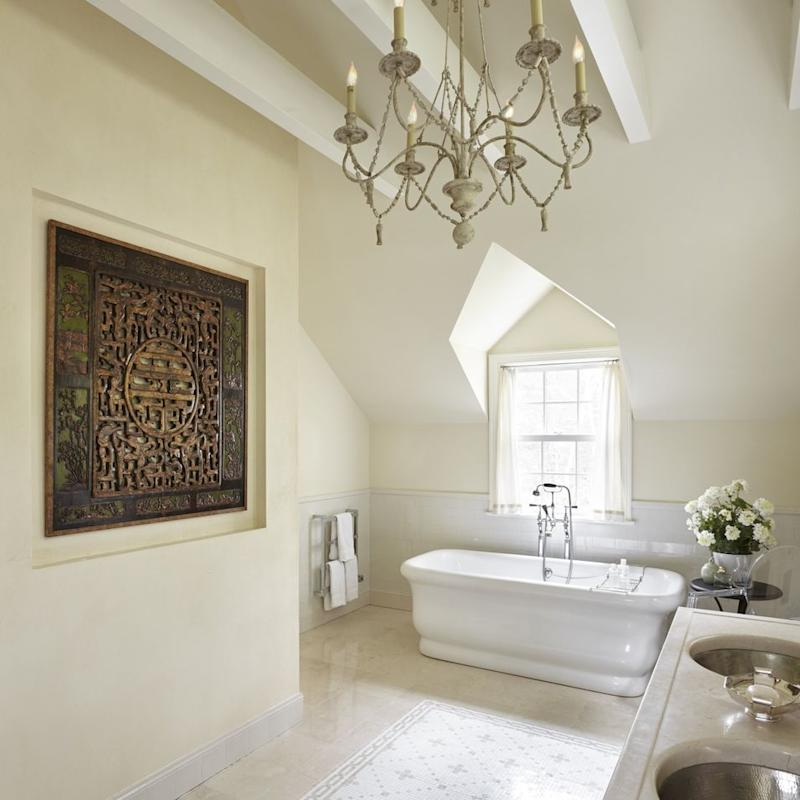 An antique Chinese door hangs in the master bath of Lissa Kutik's home in Scarsdale, NY.