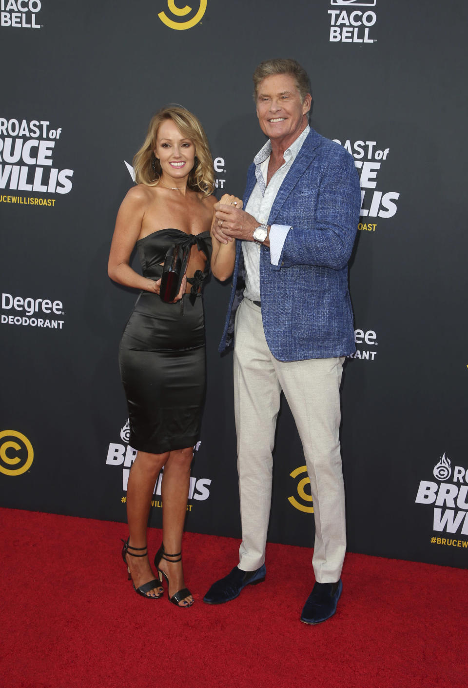 David Hasselhoff and Hayley Roberts attended Comedy Central's <em>Roast of Bruce Willis</em> on July 14, 2018, where he showed off her engagement ring — as well as flashed the wedding band belonging to his father that he repurposed for his nuptials. (Photo: Faye Sadou/MediaPunch/IPX)