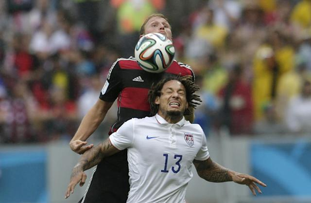 Germany's Benedikt Hoewedes, top, and United States' Jermaine Jones go for a header during the group G World Cup soccer match between the USA and Germany at the Arena Pernambuco in Recife, Brazil, Thursday, June 26, 2014. (AP Photo/Petr David Josek)