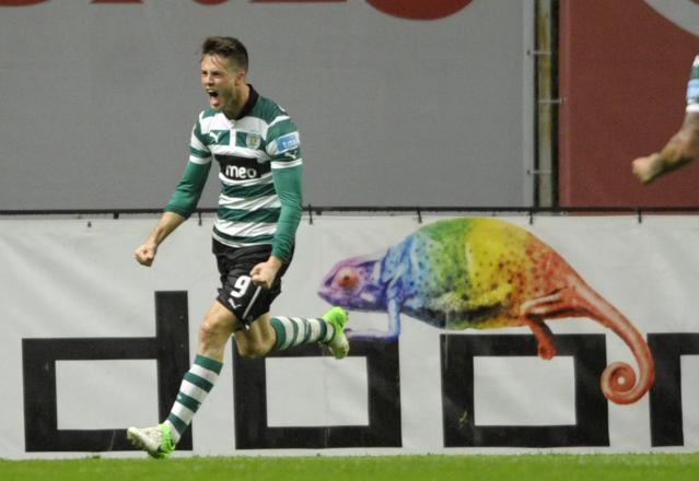 Sporting's Dutch forward Ricky van Wolfswinkel celebrates after scoring during the Portuguese league football match SC Braga vs Sporting CP at the municipal stadium in Braga on April 1, 2013. Sporting defeated Braga 3-2. AFP PHOTO / MIGUEL RIOPAMIGUEL RIOPA/AFP/Getty Images