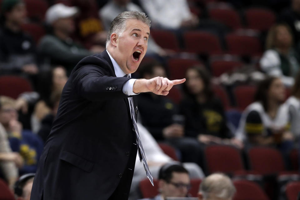 Purdue head coach Matt Painter directs his top team during the first half of an NCAA college basketball game against Minnesota in the quarterfinals of the Big Ten Conference tournament, Friday, March 15, 2019, in Chicago. (AP Photo/Nam Y. Huh)