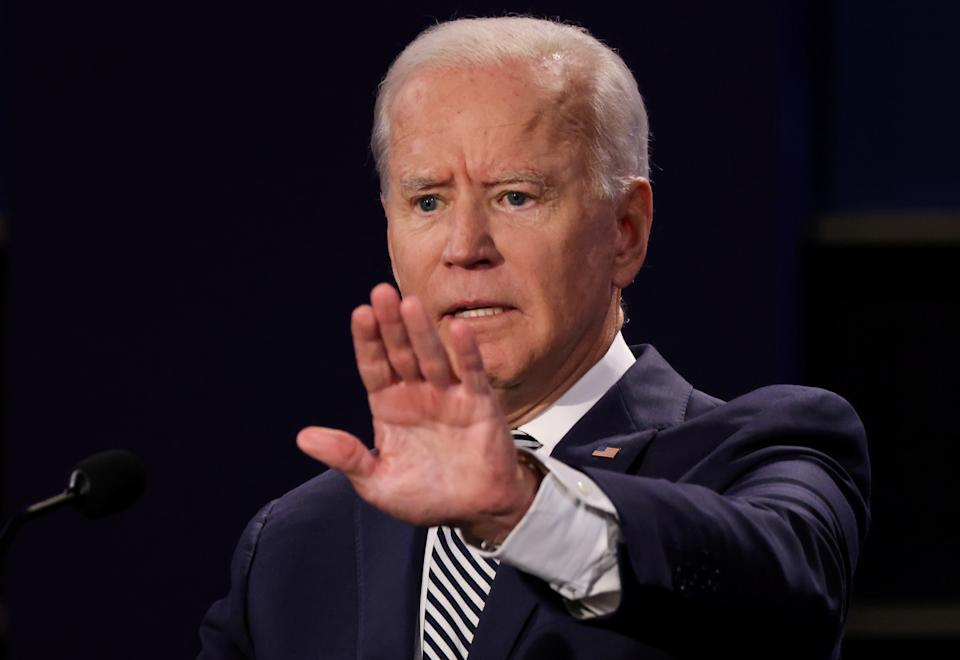 Democratic presidential nominee Joe Biden participates in the first 2020 presidential campaign debate with U.S. President Donald Trump held on the campus of the Cleveland Clinic at Case Western Reserve University in Cleveland, Ohio, U.S., September 29, 2020. REUTERS/Jonathan Ernst     TPX IMAGES OF THE DAY