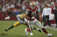 San Francisco 49ers tight end George Kittle (85) runs in front of Green Bay Packers defensive back Chandon Sullivan (39) during the second half of an NFL football game in Santa Clara, Calif., Sunday, Sept. 26, 2021. (AP Photo/Jed Jacobsohn)