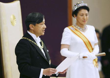 Japan's Emperor Naruhito, flanked by Empress Masako, delivers a speech during a ceremony called Sokui-go-Choken-no-gi, his first audience after the accession to the throne, at the Imperial Palace in Tokyo, May 1, 2019, in this photo released by Kyodo. Mandatory credit Kyodo/via REUTERS