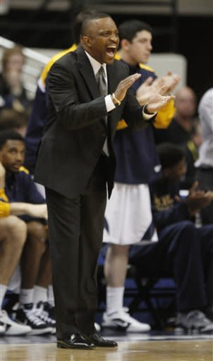Drexel head coach James Flint directs his team during the first half of the Colonial Athletic Association Championship NCAA college basketball game at the Coliseum in Richmond, Va., Monday, March 5, 2012. (AP Photo/Steve Helber)