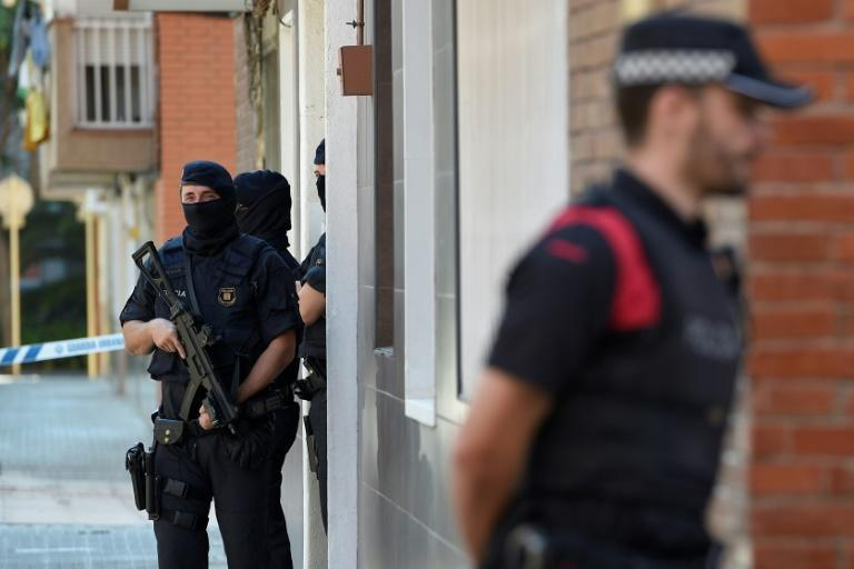 Officers searched the Algerian attacker's home, which was located just a few hundred metres (yards) from the police station
