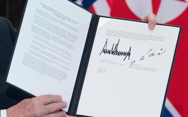 """<p>Donald Trump and Kim Jong-un in historic meeting Leaders sign 'comprehensive document' and 'leave past behind' US president declares denuclearisation to begin 'very quickly' North Korean leader says: 'The world will see a major change' Trump set to hold Press conference in Singapore at 9am BST The handshake, the meeting, the document: All we know Tim Stanley comment: Kim Jong-un is winning summit Front pages: How the world reacted to long-awaited summit Kim Jong-un has committed to """"complete denuclearisation"""" as the North Korean leader met US President Donald Trump in a historic summit after a year of exchanging warmongering threats and personal insults. In a joint agreement signed by the pair, they vowed to establish """"new"""" relations between America and North Korea in a document signed in Singapore. However, the text made no mention of US demands for """"complete, verifiable and irreversible denuclearisation"""" – jargon for scrapping weapons and committing to inspections. After a working lunch concluded a morning of negotiations, the two leaders held a signing ceremony, with Mr Trump calling it a """"comprehensive"""" agreement. Mr Kim said """"we are leaving the past behind us"""" as he said """"the world will see a major change"""". Saying he had formed a """"special bond"""" with Mr Kim, the US president said he would be inviting his North Korean counterpart to the White House. Mr Trump is due to hold a Press conference at 9am BST. Trump-Kim summit in pictures: Best photos from Donald Trump and Kim Jong-un's meeting in Singapore Asked earlier about the discussions, Mr Trump said: """"A really fantastic meeting – a lot of progress. Better than anybody could have expected. Top of the line."""" Before lunch, he hailed his """"excellent"""" relationship with Mr Kim and predicted the pair will """"solve"""" the Korean Peninsula stand-off after their historic meeting. The US president said his one-on-one meeting with the North Korean leader, which lasted around 40 minutes, was """"very good"""" and predicted """"tremendo"""