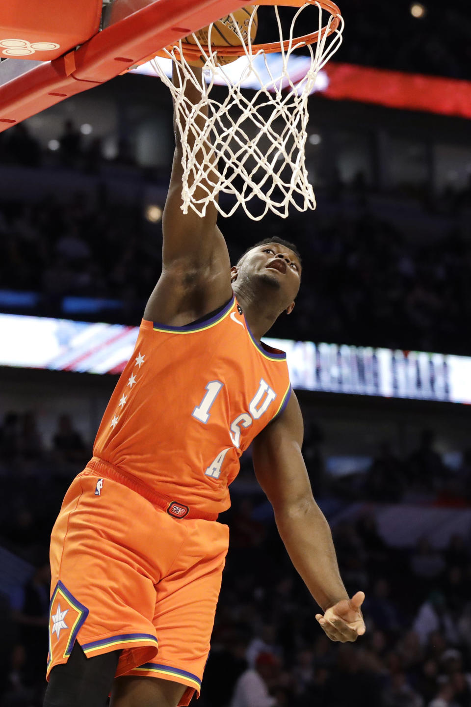 Team USA forward Zion Williamson, of the New Orleans Pelicans, dunks against during the second half against Team World in the NBA Rising Stars basketball game in Chicago, Friday, Feb. 14, 2020. (AP Photo/Nam Y. Huh)