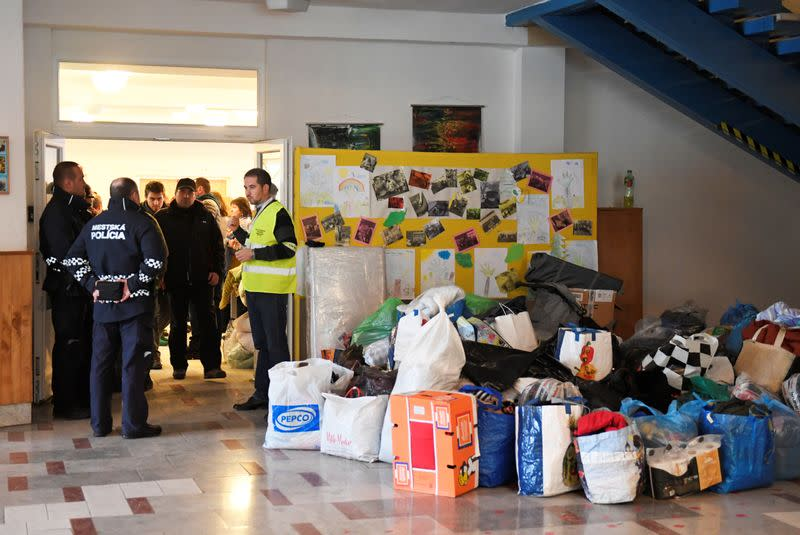 Families from an apartment building damaged by a gas explosion arrive to a temporary accomodation in Presov