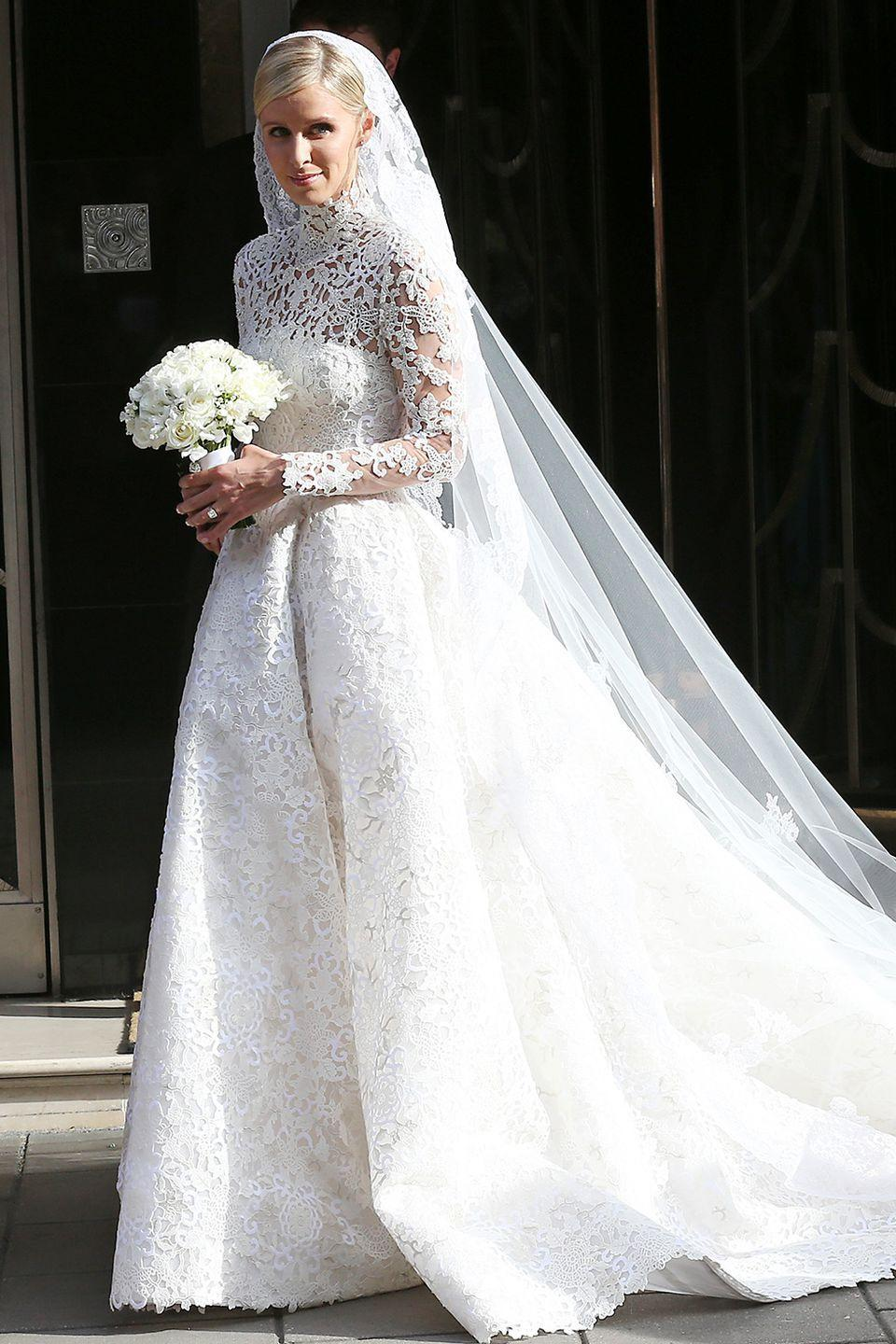 <p>Nicky (sister of Paris!) married her banker hubby in London wearing a beautiful Valentino Haute Couture gown with lace sleeves and crystal detailing. Note the similarity to Kate Middleton's gown? </p>