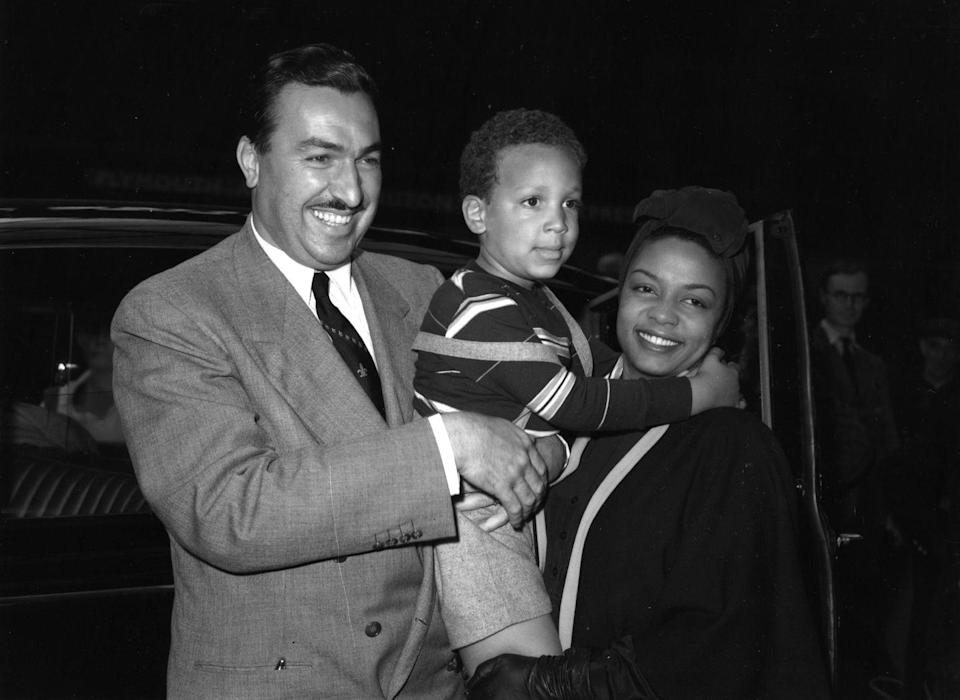 <p>The jazz musician attends an event in with her husband, Adam Clayton Powell, Jr., and their son, Adam Clayton Powell III. </p>