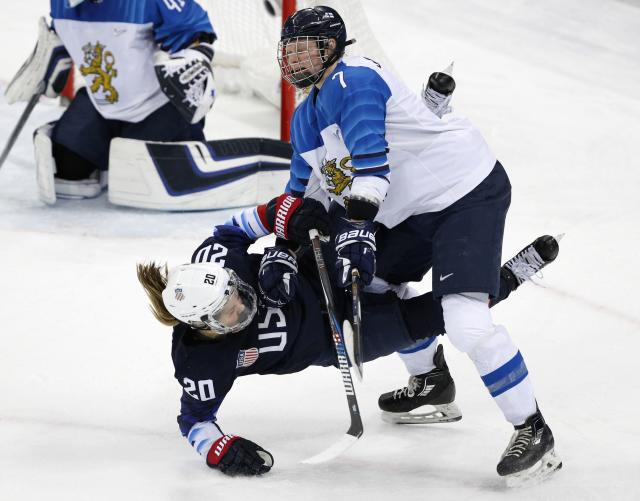 <p>Hannah Brandt of U.S. and Mira Jalosuo of Finland (R) in action. REUTERS/Brian Snyder </p>