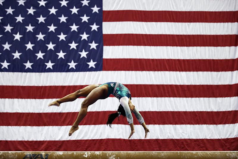 KANSAS CITY, MISSOURI - AUGUST 09: Simone Biles competes on the balance beam during the Senior Women's competition of the 2019 U.S. Gymnastics Championships at the Sprint Center on August 09, 2019 in Kansas City, Missouri. (Photo by Jamie Squire/Getty Images)