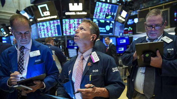 PHOTO: Traders and financial professionals work on the floor of the New York Stock Exchange (NYSE) at the opening bell on August 13, 2019, in New York. (Drew Angerer/Getty Images)