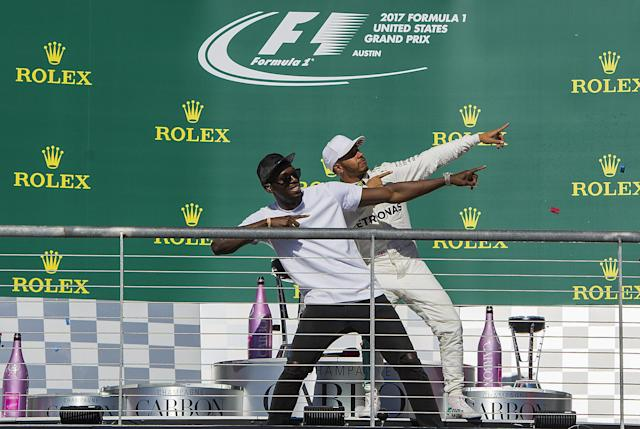 Top cats: Usain Bolt and Lewis Hamilton throw a familiar shape on the Austin podium at the 2017 US Grand Prix