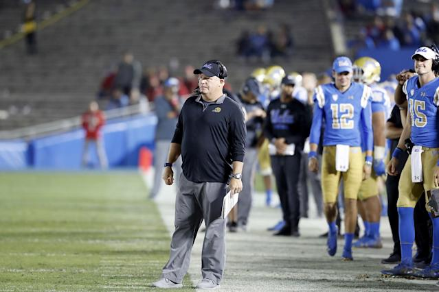 """UCLA coach Chip Kelly watches the Bruins lose to Utah in a largely empty Rose Bowl on Oct. 26, 2018. <span class=""""copyright"""">(Luis Sinco / Los Angeles Times)</span>"""
