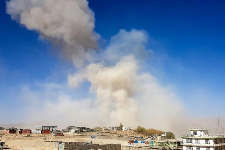 Smoke rises from the site of a car bomb attack that targeted an Afghan police headquarters in Feroz Koh