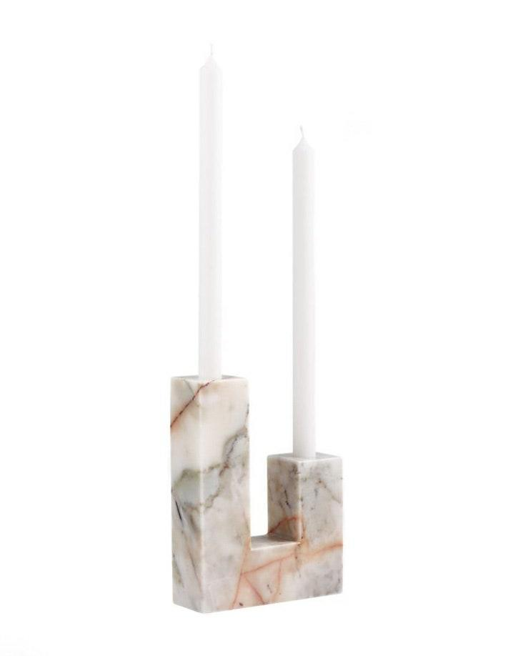"If a resy at her favorite dinner spot is not on the books for May 9, this elegant marble candle holder will make any at-home meal feel special. Order by May 3 to ensure it arrives in time for din-din. $70, CB2. <a href=""https://www.cb2.com/decks-holds-2-red-marble-taper-candle-holder/s482909"" rel=""nofollow noopener"" target=""_blank"" data-ylk=""slk:Get it now!"" class=""link rapid-noclick-resp"">Get it now!</a>"