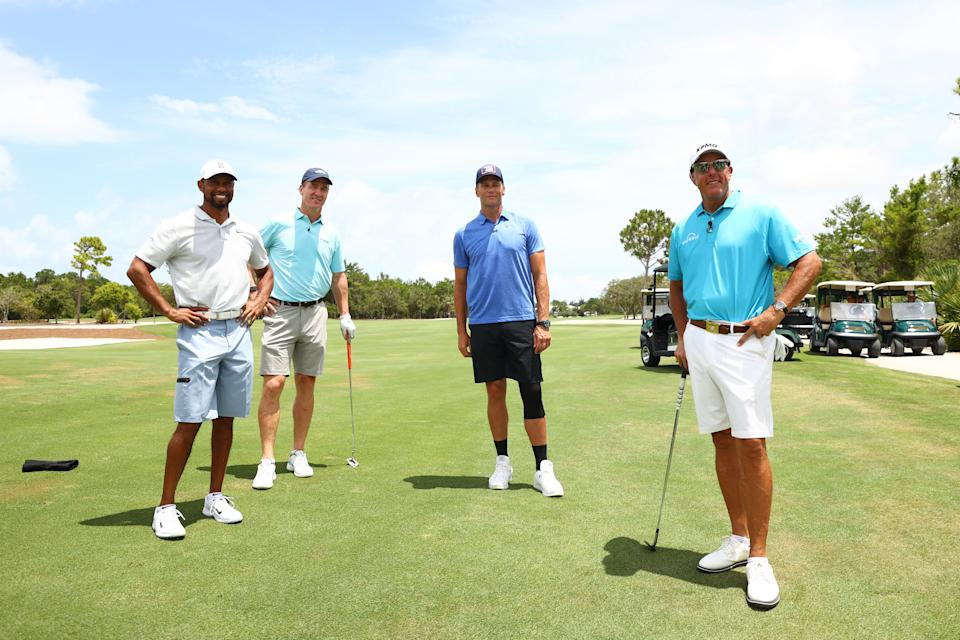 Tiger Woods, Peyton Manning, Tom Brady and Phil Mickelson pose for a photo during a practice round for The Match: Champions For Charity at Medalist Golf Club on May 23, 2020 in Hobe Sound, Florida.