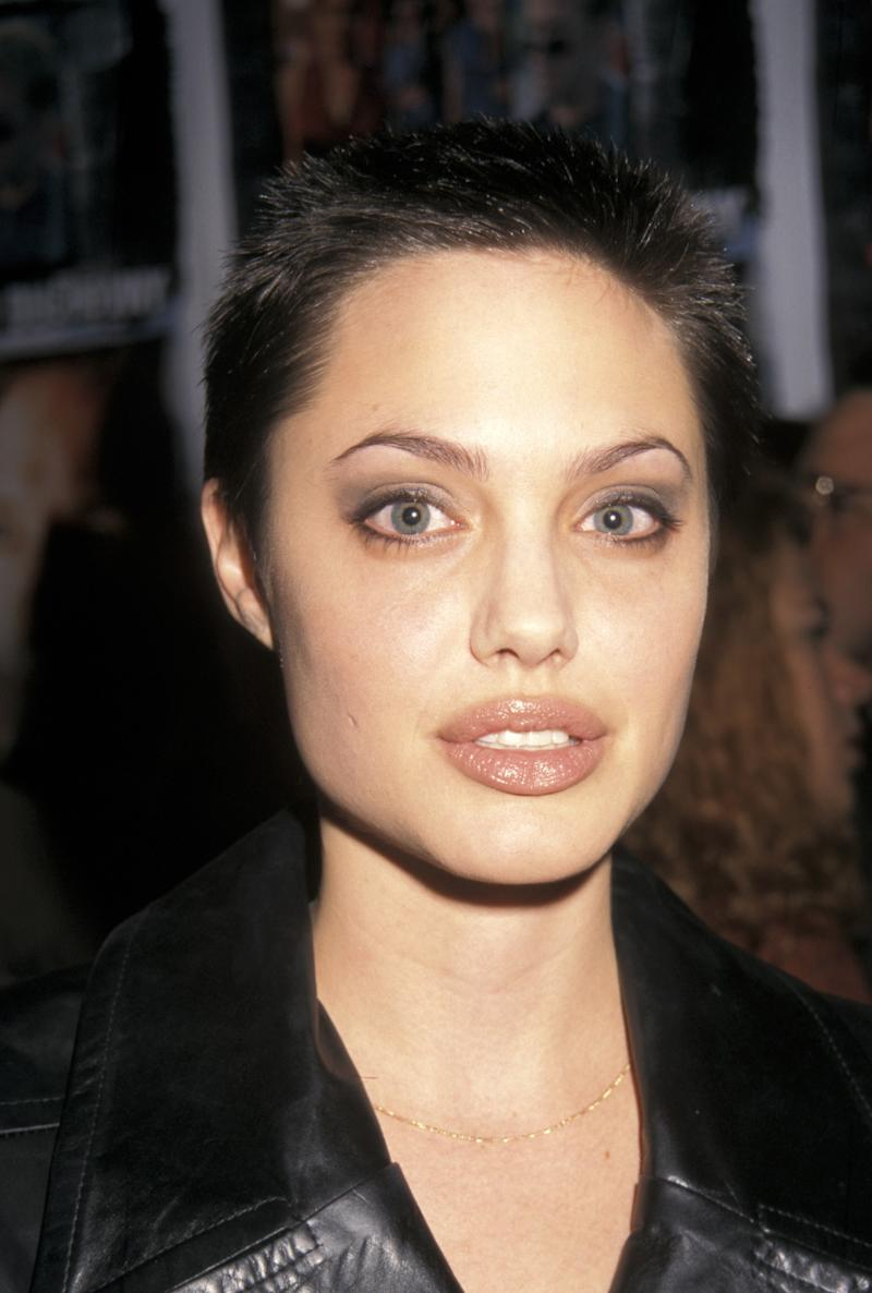 This buzz showed off Jolie's bee-stung lips and high cheekbones. Angelina Jolie at the premiere of Playing God in New York, New York, October 1997. Photo by Getty Images.