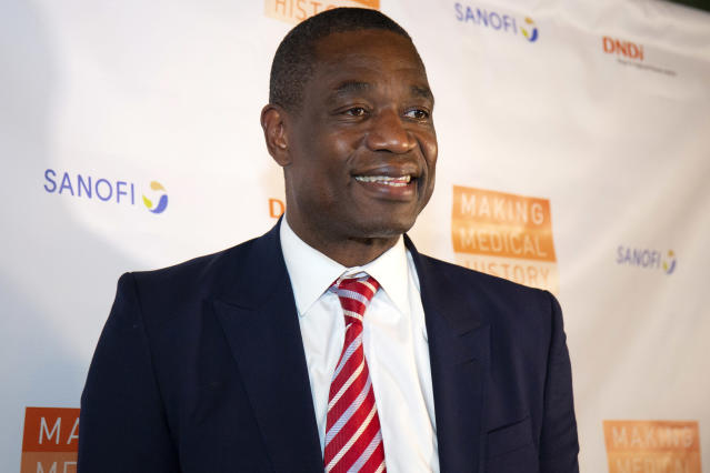 Dikembe Mutombo is changing the life of a young boy who has been shunned by society due to the large tumor on his face. (Santiago Felipe/Getty Images)