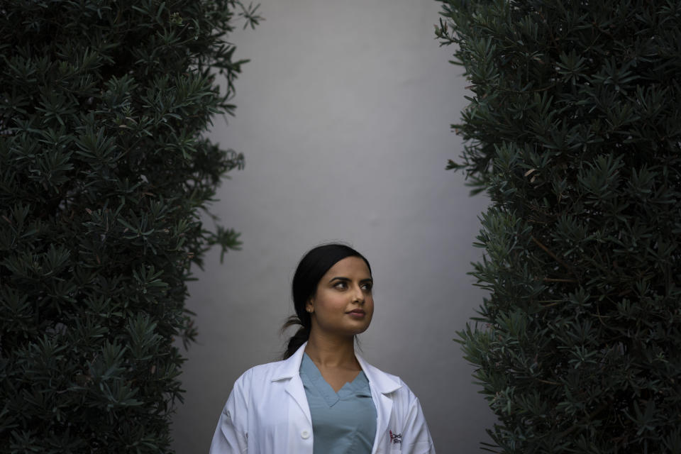 """Rose Kaur Sodhi, a medical resident at Cedars-Sinai Medical Center, stands for a portrait Wednesday, Aug. 18, 2021, in Los Angeles. Rose, Balbir Singh Sodhi's niece, was a second grader getting ready for a relative's birthday party when her family learned of her uncle's murder. """"We knew something was terribly wrong because my dad came home crying. I had never seen that before,"""" she said of her father and Balbir's brother, Rana Singh Sodhi, who became a well-known figure in the Sikh American community and taught her to share her family's story and advocate for peace. (AP Photo/Jae C. Hong)"""