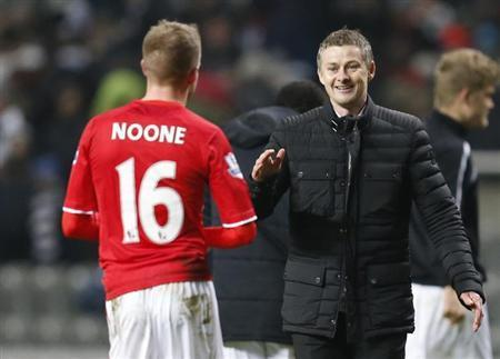 Cardiff City manager Ole Gunnar Solskjaer congratulates player Craig Noone after their English FA Cup soccer match against Newcastle United at St James' Park stadium in Newcastle, northern England January 4, 2014. REUTERS/Russell Cheyne