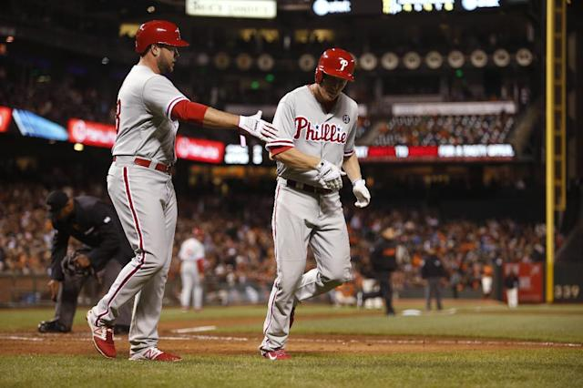 Philadelphia Phillies' Cody Asche, right, is congratulated by Darin Ruf after Asche hit a two-run home run during the eighth inning of a baseball game against the San Francisco Giants, Friday Aug. 15, 2014, in San Francisco. (AP Photo/Beck Diefenbach)
