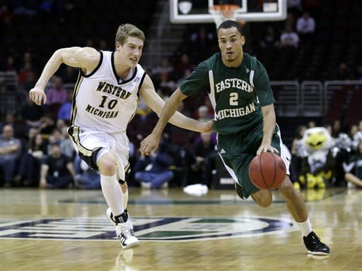 Eastern Michigan's J.R. Sims (2) drives past Western Michigan's Brandon Pokley (10) in the first half during an NCAA college basketball game at the Mid-American Conference men's tournament on Thursday, March 14, 2013, in Cleveland. (AP Photo/Tony Dejak)