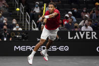Team World's Felix Auger-Aliassime, of Canada, returns the ball to Team Europe's Matteo Berrettini, of Italy, at Laver Cup tennis, Friday, Sept. 24, 2021, in Boston. (AP Photo/Elise Amendola)