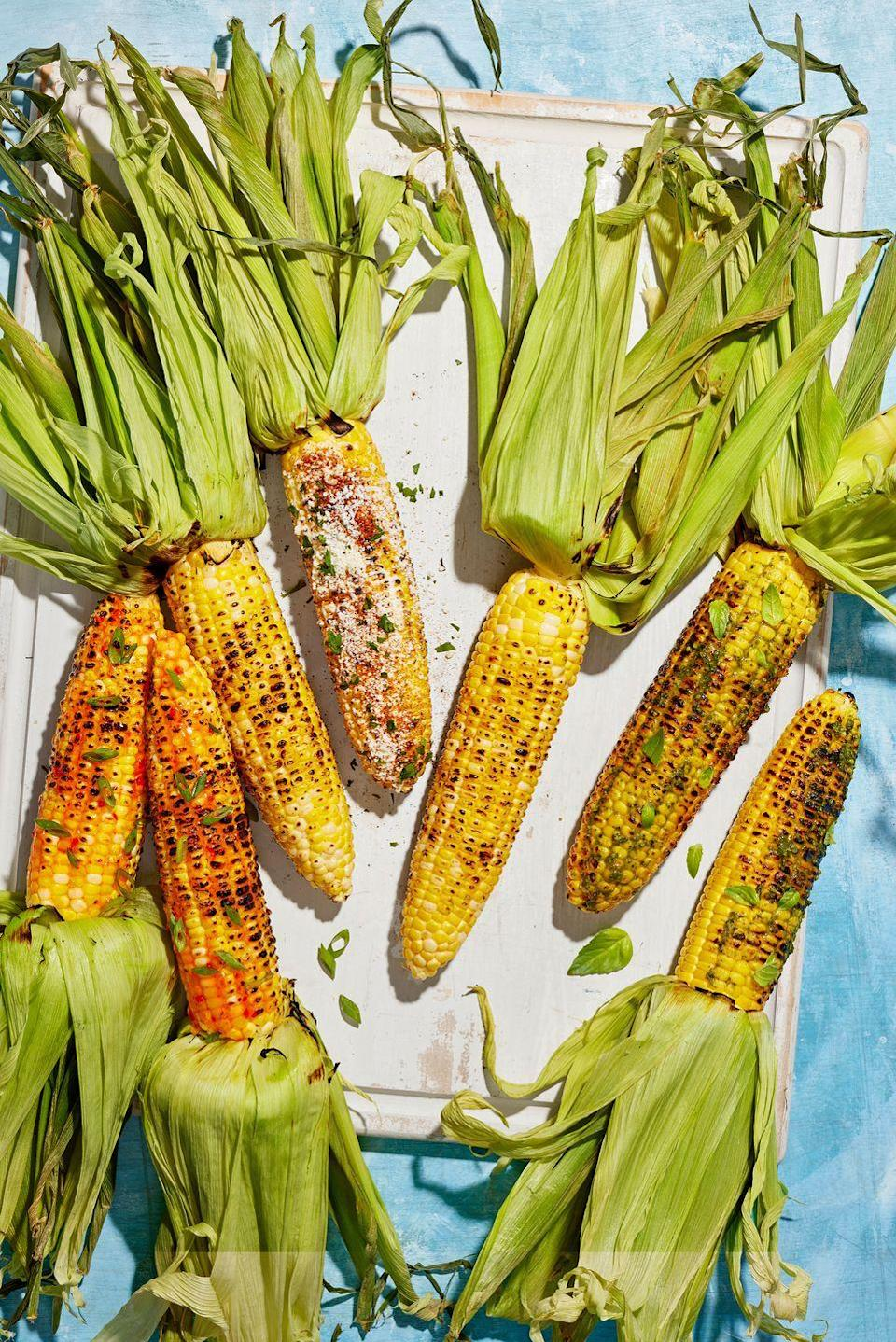 """<p>Corn on the cob hot off the grill is a guaranteed summer delight. But when dressed up, this sweet roasted veggie tastes even better. </p><p><strong><a href=""""https://www.countryliving.com/food-drinks/a36741693/grilled-corn-with-red-pepper-jelly-glaze-recipe/"""" rel=""""nofollow noopener"""" target=""""_blank"""" data-ylk=""""slk:Get the recipe for Grilled Corn with Red Pepper Jelly Glaze"""" class=""""link rapid-noclick-resp"""">Get the recipe for Grilled Corn with Red Pepper Jelly Glaze</a>.</strong></p><p><strong><strong><a href=""""https://www.countryliving.com/food-drinks/a36742046/grilled-corn-with-mexican-street-style-topping-recipe/"""" rel=""""nofollow noopener"""" target=""""_blank"""" data-ylk=""""slk:Get the recipe for Grilled Corn with Mexican &quot;Street Style&quot; Topping"""" class=""""link rapid-noclick-resp"""">Get the recipe for Grilled Corn with Mexican """"Street Style"""" Topping</a>.</strong><br></strong></p><p><strong><a href=""""https://www.countryliving.com/food-drinks/a36742152/grilled-corn-with-pesto-and-basil-schmear-recipe/"""" rel=""""nofollow noopener"""" target=""""_blank"""" data-ylk=""""slk:Get the recipe for Grilled Corn with Pesto and Basil Schmear"""" class=""""link rapid-noclick-resp""""><strong>Get the recipe for Grilled Corn with Pesto and Basil Schmear</strong></a>.<br></strong></p>"""