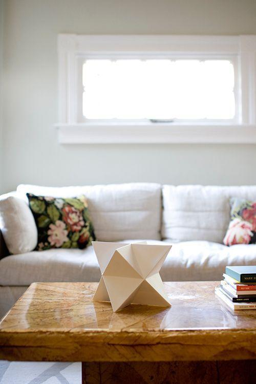 "<p>Origami transforms paper into a cheap and chic decor piece for a tabletop, mantle or shelf. Cluster several together in white for a snowy look.</p><p><em><a href=""https://www.kristimurphy.com/blog/diy-origami"" rel=""nofollow noopener"" target=""_blank"" data-ylk=""slk:Get the tutorial at Kristi Murphy»"" class=""link rapid-noclick-resp"">Get the tutorial at Kristi Murphy»</a></em><br></p>"