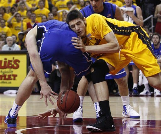 Maryland center Alex Len, right, of Ukraine, gets tangled with Duke forward Miles Plumlee as they struggle for possession of the ball in the first half of an NCAA college basketball game in College Park, Md., Wednesday, Jan. 25, 2012. (AP Photo/Patrick Semansky)