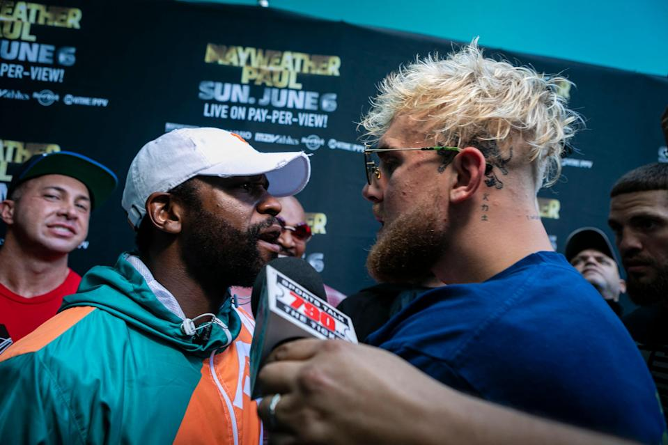 <p>Mayweather and Jake Paul face off</p> (AFP via Getty Images)