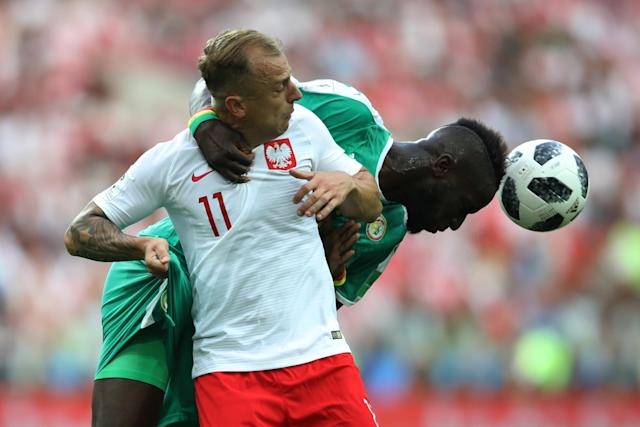 Soccer Football - World Cup - Group H - Poland vs Senegal - Spartak Stadium, Moscow, Russia - June 19, 2018 Senegal's Salif Sane in action with Poland's Kamil Grosicki REUTERS/Carl Recine