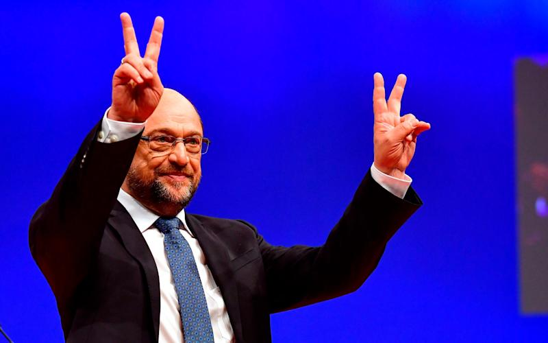 Martin Schulz gestures after delivering a speech during a party congress of Germany's Social Democrats in Berlin, on December 7 - AFP
