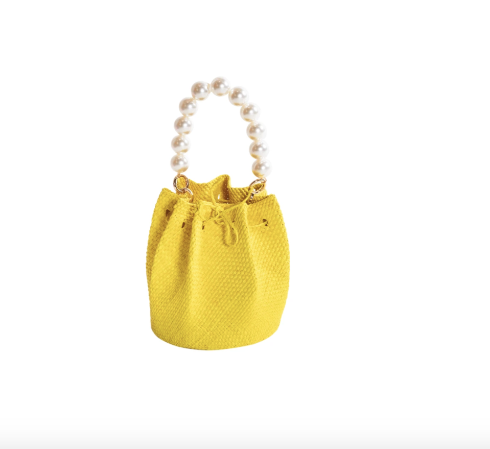 """<p><strong>Soraya Hennessy</strong></p><p>sorayahennessy.com</p><p><strong>$160.00</strong></p><p><a href=""""https://sorayahennessy.com/collections/baskets/products/yellow-coqueta-iraca-basket-bucket-bag"""" rel=""""nofollow noopener"""" target=""""_blank"""" data-ylk=""""slk:Shop Now"""" class=""""link rapid-noclick-resp"""">Shop Now</a></p><p>A beaded handle on a woven bucket bag shape is way chic, but add this bright color into the mix, and the compliments will be rolling in. </p>"""