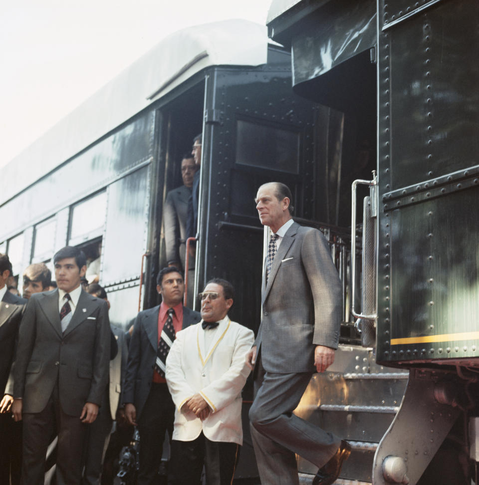 Prince Philip, the Duke of Edinburgh disembarks from a train during his state visit to Mexico, 1975. (Photo by Serge Lemoine/Getty Images)