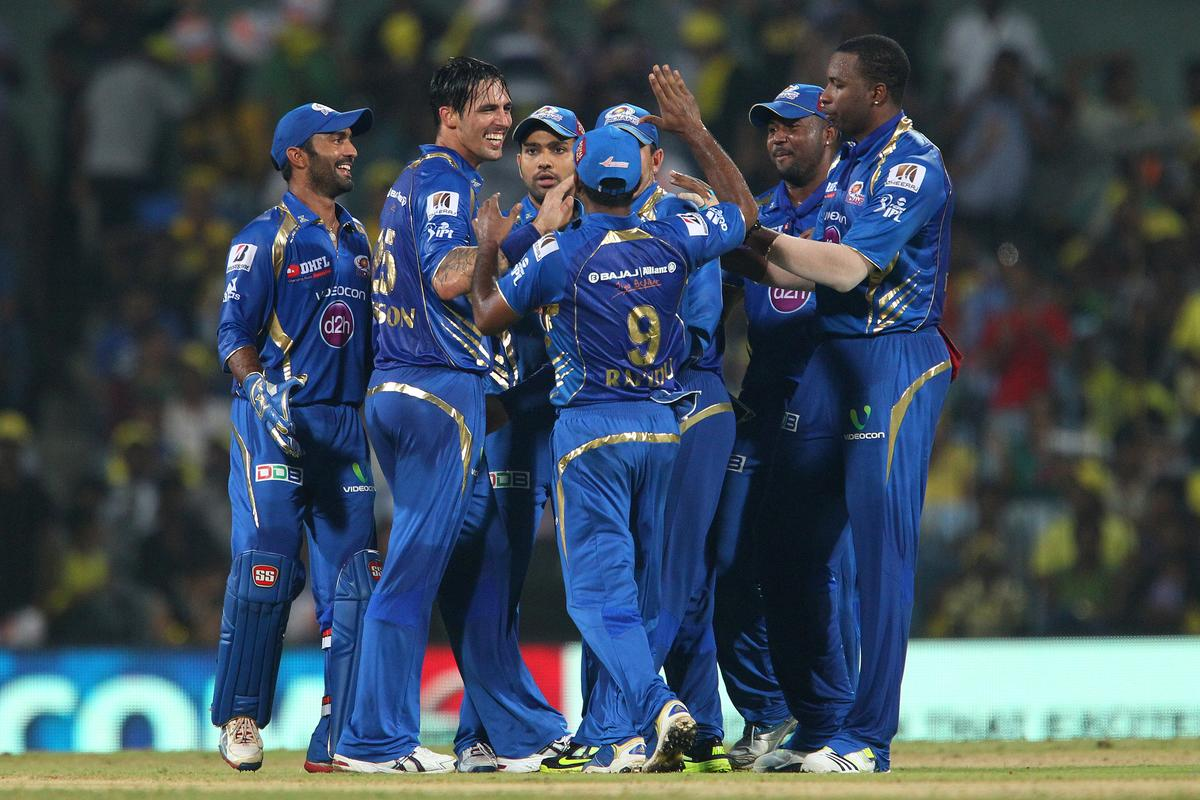 Mitchell Johnson celebrates the wicket of Suresh Raina during match 5 of of the Pepsi Indian Premier League between The Chennai Superkings and the Mumbai Indians held at the MA Chidambaram Stadiumin Chennai on the 6th April 2013..Photo by Ron Gaunt-IPL-SPORTZPICS ..Use of this image is subject to the terms and conditions as outlined by the BCCI. These terms can be found by following this link:..https://ec.yimg.com/ec?url=http%3a%2f%2fwww.sportzpics.co.za%2fimage%2fI0000SoRagM2cIEc&t=1490345157&sig=u4L5yKRmIygS3a7fWTth3Q--~C