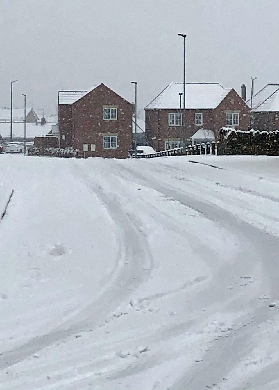 Snow covers a road in Monk Bretton, Barnsley, South YorkshirePA