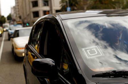 Uber logo is seen on a vehicle near Union Square in San Francisco, California