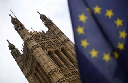 A flag of the European Union is pictured outside the Houses of Parliament in London