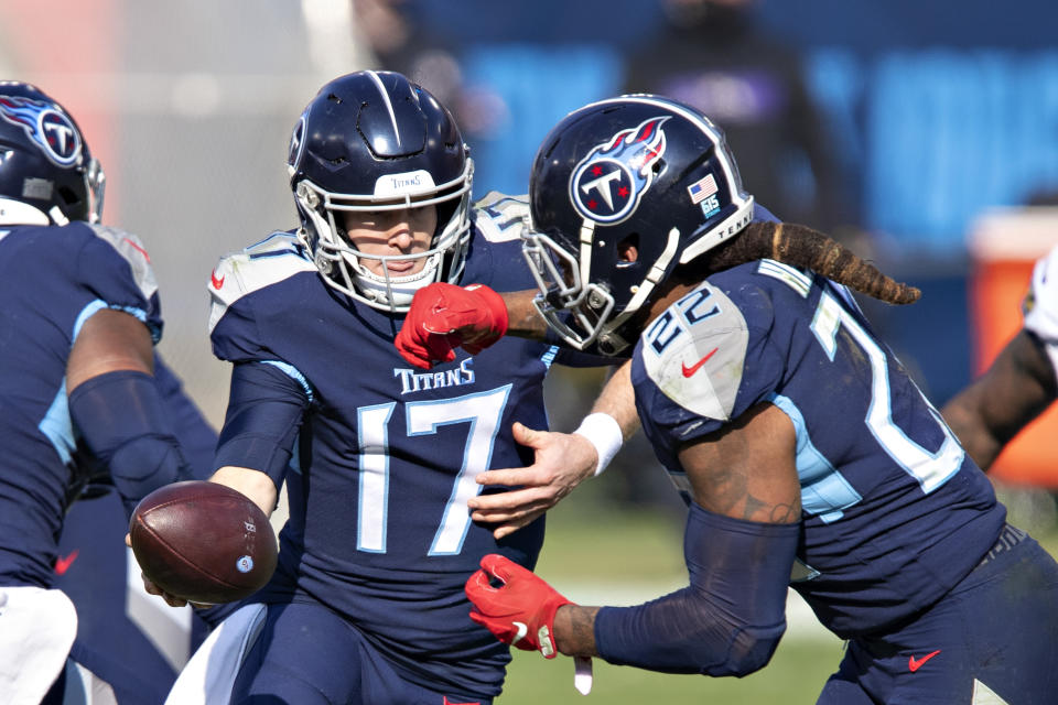 Ryan Tannehill hands off the ball to Derrick Henry during their AFC wild card playoff game against the Ravens on Jan. 10. (Wesley Hitt/Getty Images)