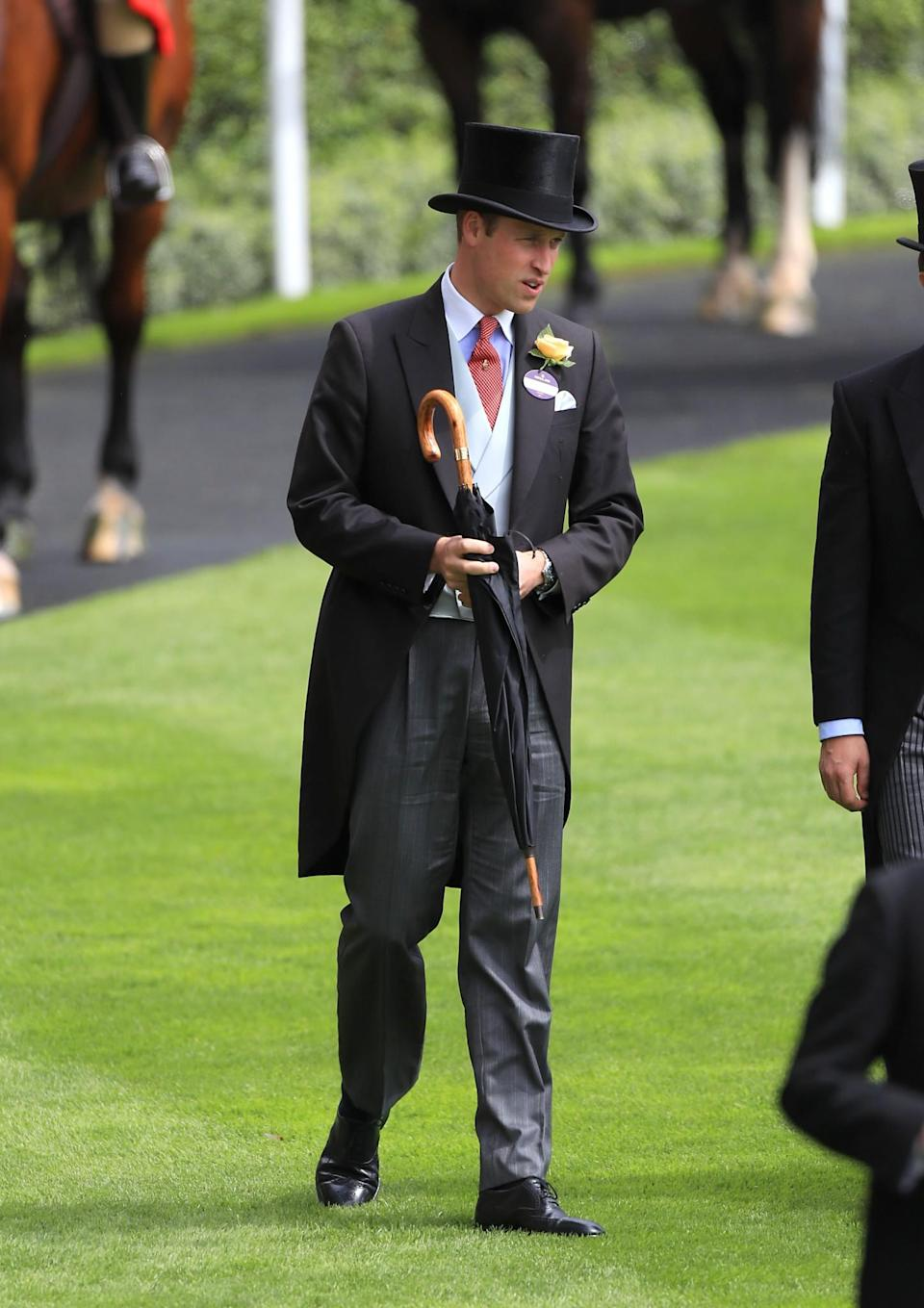 <p>In 2016, William dressed in coat and tails with an umbrella for an accessory.<br><i>[Photo: PA]</i> </p>