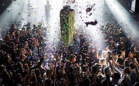 A depiction of a cannabis bud drops from the ceiling at Leafly's countdown party in Toronto on Wednesday - Credit: Chris Young