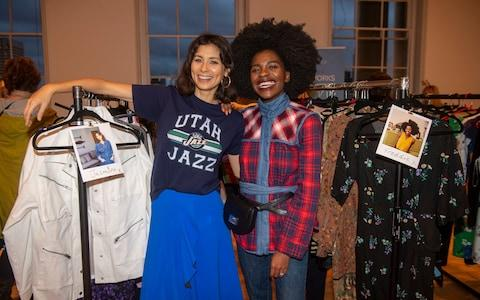 Jasmine Hemsley and Freddie Harrel by their stands of donated clothes  - Credit: Paul Grover