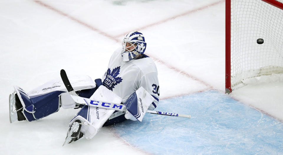 Toronto Maple Leafs goaltender Michael Hutchinson drops to the ice as the puck flies into the net on a goal by Boston Bruins right wing Brett Ritchie during the third period of an NHL hockey game in Boston, Tuesday, Oct. 22, 2019. (AP Photo/Charles Krupa)