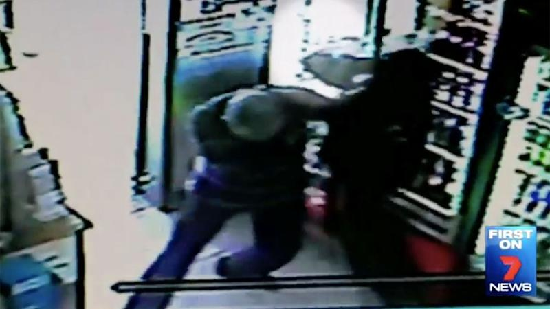 This is the shocking moment Mr Shaw is stabbed in the lower back with the thug's knife. Photo: 7 News